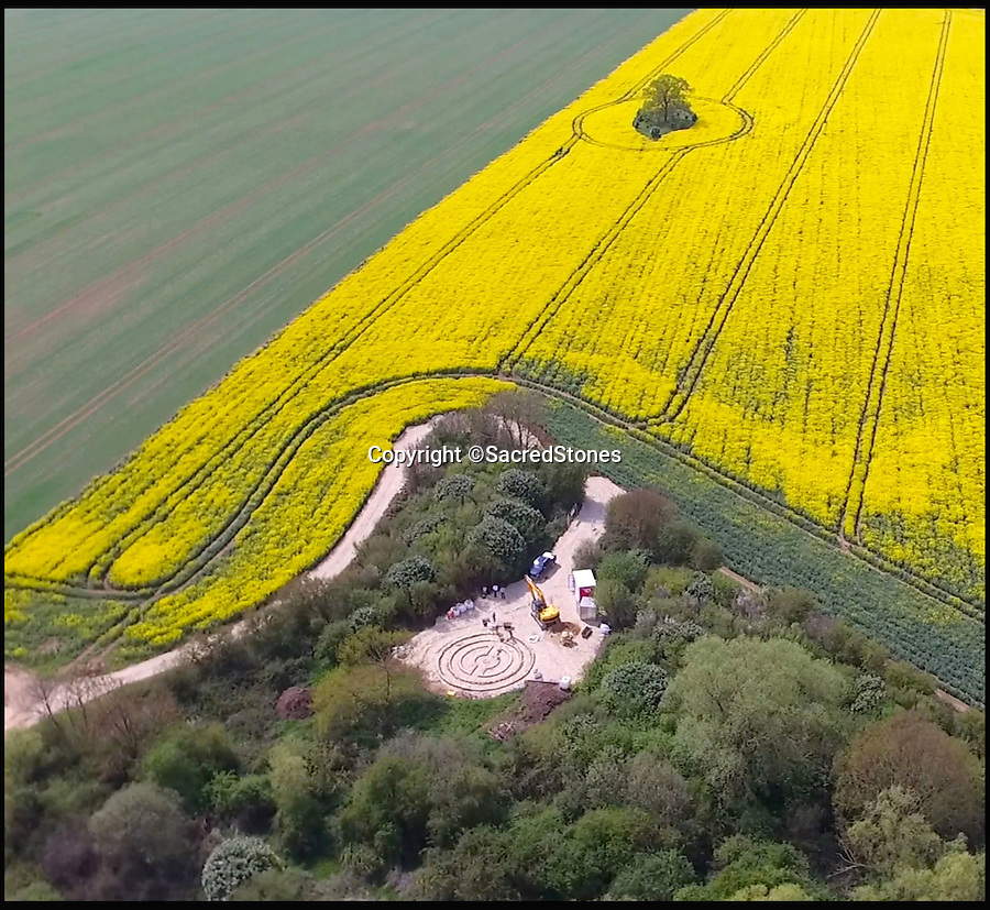 BNPS.co.uk (01202 558833)<br /> Pic: SacredStones/BNPS<br /> <br /> Work starting on the new St Neots barrow in Cambridgeshire.<br /> <br /> Building boom after 4000 years - Neolithic barrows are being built again as burial mounds for modern Britons.<br /> <br /> Prehistoric tombs used to store the ashes of loved ones are being built on UK soil for the first time in thousands of years. <br /> <br /> Until now Neolithic earth mounds built over the dead, known as long barrows, had not been used since around 2,000 BC. <br /> <br /> The limestone frame covered in soil and grass was entirely handmade by a team of four stonemasons using traditional techniques over the course of five months. <br /> <br /> The firm will be selling 400 plots, or niches, near Hail Weston, Cambs, for between £1,950 and £4,800.