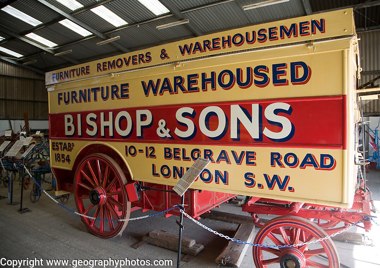 Horse stud, stables and tourist attraction at The Suffolk Punch Trust, Hollesley, Suffolk, England. Old Bishop & Sons furniture removers vehicle.