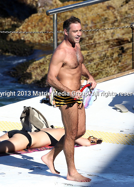 11 MARCH 2014 SYDNEY AUSTRALIA<br /> <br /> EXCLUSIVE <br /> <br /> Andrew O'Keefe pictured at Icebergs having a swim in his bumble bee budgie smugglers.<br /> <br /> *No internet without clearance*<br /> MUST CALL PRIOR TO USE .<br /> +61 2 9211-1088<br /> Matrix Media Group<br /> Note: All editorial images subject to the following: For editorial use only. Additional clearance required for commercial, wireless, internet or promotional use.Images may not be altered or modified. Matrix Media Group makes no representations or warranties regarding names, trademarks or logos appearing in the images.