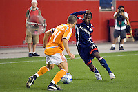 New England Revolution midfielder Sainey Nyassi (31) is marked by Houston Dynamo defender Wade Barrett (24). The New England Revolution defeated the Houston Dynamo 2-2 (6-5) in penalty kicks in the SuperLiga finals at Gillette Stadium in Foxborough, MA, on August 5, 2008.
