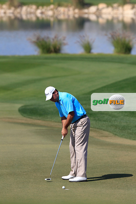 Keith Horne (RSA) putts on the 15th green during Wednesday's Round 1 of the Commercial Bank Qatar Masters 2013 at Doha Golf Club, Doha, Qatar 23rd January 2013 .Photo Eoin Clarke/www.golffile.ie