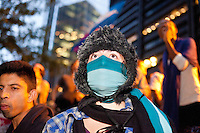 "Protesters with the ""Occupy Wall Street"" movement gather by the thousands in the early morning of October 14, 2011 at Zuccotti Park in New York City.  Brookfield Properties, owners of the private park, had requested the NYPD's assistance in evacuating the park to facilitate a routine cleaning.  With protesters gathered en masse and a confrontation likely, Brookfield rescinded their request at the last minute."
