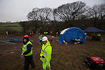 A huge  security operation is mounted at  Combe Haven defenders  the site of the Bexhill to Hastings bypass .  The controversial proposed route cuts through an  area of outstanding natural beauty and has outraged many local people. It will cos tthe taxpayer over £100 million