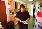 Crystal Hernandez reads a runaway note by her daughter Jaziman (age15) that was left hanging in the kitchen.