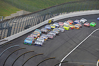Jimmie Johnson (#48) and Aric Almirola (#43) lead the field back to the green flag.
