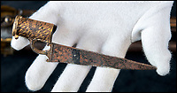 BNPS.co.uk (01202) 558833<br /> Pic: PhilYeomans/BNPS<br /> <br /> The stylised tiger stripes are repeated on the muskets battle damaged bayonet.<br /> <br /> Stunning artefacts from Indian hero Tipu Sultan's fateful last stand have been rediscovered by the family of an East India Company Major who took part in the famous battle that ended his reign.<br /> <br /> And now Major Thomas Hart's lucky descendents are likely to become overnight millionaires after retrieving the historic items from their dusty attic.<br /> <br /> The fascinating treasures were taken from Tipu's captured fortress of Seringapatam in the wake of his defeat by British forces led by a young Duke of Wellington in 1799.<br /> <br /> The cache of ornate gold arms and personal effects even include's the battle damaged musket the Sultan used in his fatal last stand against the expanding British Empire in India.<br /> <br /> Tipu was last seen on the battlements of the fortress firing his hunting musket at the advancing British and after the fierce encounter his body was found bearing many wounds, including a musket ball shot above his right eye.<br /> <br /> The rediscovered musket, complete with battle damaged bayonet, has the distinctive tiger stripe pattern unique to the self styled Tiger of Mysore own weapons - and tellingly there is also shot damage to the lock and stock that may have been caused by the musket ball that finished him off.<br /> <br /> Also included in the sale are four ornate gold-encrusted sword's bearing the mark of Haider Ali Khan, Tipu's father and the previous ruler of independent Mysore, along with a solid gold &lsquo;betel casket&rsquo; complete with three 220 year old nuts still inside.<br /> <br /> The war booty was brought back to Britain by Major Thomas Hart of the British East India Company following the fourth and final Anglo-Mysore war.<br /> <br /> They have been passed down through the family ever since and now belong to a couple who have kept them wrapped in newspaper in the dusty attic of their semi-detached home for years.