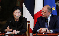 Il Primo Ministro thailandese Yingluck Shinawatra ed il Presidente del Consiglio Enrico Letta tengono una conferenza stampa congiunta al termine del loro incontro a Palazzo Chigi, Roma, 11 settembre 2013.<br /> Thai Prime Minister Yingluck Shinawatra, left, and Italian Premier Enrico Letta attend a joint press conference at the end of their meeting at Chigi Palace, Rome, 11 September 2013.<br /> UPDATE IMAGES PRESS/Isabella Bonotto