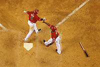 Apr. 14, 2009; Phoenix, AZ, USA; Arizona Diamondbacks players (6) Stephen Drew and (10) Justin Upton celebrate the game winning hit by Eric Byrnes (not pictured) in the tenth inning against the St. Louis Cardinals at Chase Field. The Diamondbacks defeated the Cardinals 7-6 in 10 innings. Mandatory Credit: Mark J. Rebilas-