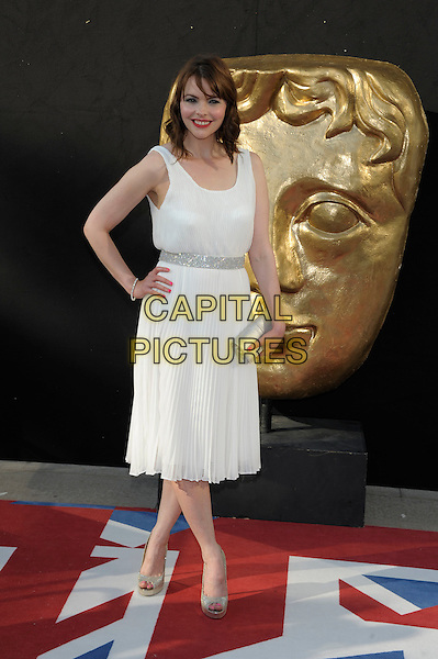 Kate Ford.Arrivals at the Arqiva British Academy Television Awards held at the Royal Festival Hall, London, England..May 27th, 2012.BAFTA BAFTAS full length white sleeveless dress hand on hip clutch bag silver  .CAP/PL.©Phil Loftus/Capital Pictures.
