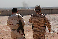 "14.06.14 JALULA, DIYALA PROVINCE, KURDISTAN<br /> Memebrs of the Kurdish armed fighting force ""Peshmerga"" look out over Jalula during heavy fighting between Kurdish forces and ISIS militants. The ISIS militia have gained significant ground across the top of Iraq after taking major city Mosul, and are currently trying to push south toward Baghdad."