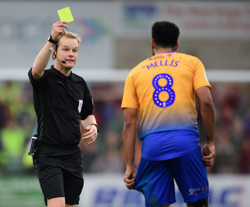 Mansfield Town's Jacob Mellis is shown a yellow card by referee Gavin Ward<br /> <br /> Photographer Chris Vaughan/CameraSport<br /> <br /> The EFL Sky Bet League Two - Lincoln City v Mansfield Town - Saturday 24th November 2018 - Sincil Bank - Lincoln<br /> <br /> World Copyright © 2018 CameraSport. All rights reserved. 43 Linden Ave. Countesthorpe. Leicester. England. LE8 5PG - Tel: +44 (0) 116 277 4147 - admin@camerasport.com - www.camerasport.com