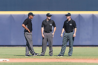 Field umpires Jeremie Rehak, Blake Carnahan, and Brennan Miller during an Arizona Fall League game between the Scottsdale Scorpions and the Peoria Javelinas at Peoria Sports Complex on October 18, 2018 in Peoria, Arizona. Scottsdale defeated Peoria 8-0. (Zachary Lucy/Four Seam Images)
