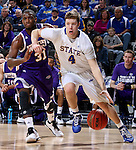 SIOUX FALLS, SD - MARCH 7:  Jake Bittle #4 of South Dakota State battles Garret Covington  #31 of Western Illinois for the ball in the second half of the first round of the men's Summit League Championship Tournament game Saturday evening at the Denny Sanford Premier Center in Sioux Falls, SD. (Photo by Dave Eggen/Inertia)