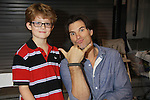 Austin Peck (ATWT & Days) and fan Kameron as he attended the Home & Leisure Show on October 16, 2011 at the Capital Clubhouse, Waldorf, Maryland. Austin and Terri signed autographs, took photos and roamed around the show and had fun.  (Photo by Sue Coflin/Max Photos)