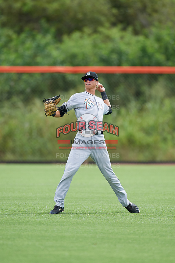 GCL Marlins Connor Scott (24) warms up in the outfield before a game against the GCL Mets on August 3, 2018 at St. Lucie Sports Complex in Port St. Lucie, Florida.  GCL Mets defeated GCL Marlins 3-2.  (Mike Janes/Four Seam Images)