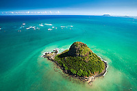 An aerial perspective of Chinaman's Hat with Lanikai in the far distance on O'ahu.
