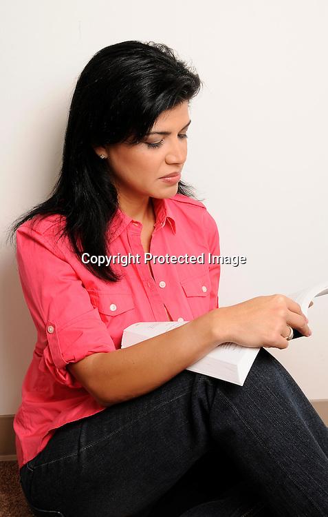 Beautiful Hispanic Woman reading