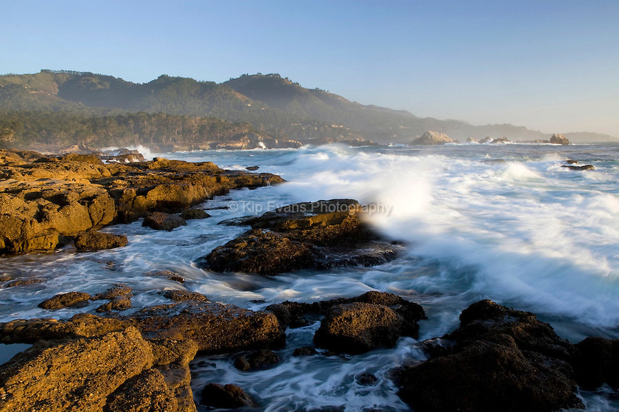 Waves crash along the shore at Point Lobos State Park, California.