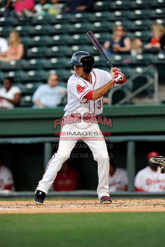 Shortstop Javier Guerra (31) of the Greenville Drive bats in a game against the Lexington Legends on Tuesday, April 14, 2015, at Fluor Field at the West End in Greenville, South Carolina. Lexington won, 5-3. (Tom Priddy/Four Seam Images)