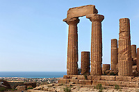 Low angle view of columns with part of frieze, Temple of Juno or Hera Lacinia, c.450 BC, Agrigento, Sicily, Italy,  pictured on September 11, 2009, in the morning. This temple was built on an artificial spur. Standing on a high rectangular platform above four steps its 34 fluted columns consist of four tamburi or drums and are each 6.32 meters high. After being damaged in the fire of 406 BC it was restored in Roman times, and again in 1787 by the Prince of Torremuzza. The Valley of the Temples is a UNESCO World Heritage Site. Picture by Manuel Cohen.