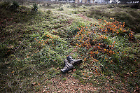 In this Sunday, Dec. 16, 2012 photo, an abandoned pair of boots from a Syrian army soldier remain at the battlefield in where heavy clashes took place inside one militar academy besieged by rebels at the north of Aleppo, Syria. The Free Syrian Army took control over the Academy after several hours battling the troops loyal to President Bashar al-Assad. Among the casualities are one FSA General and one Syrian journalist. (AP Photo/Narciso Contreras)