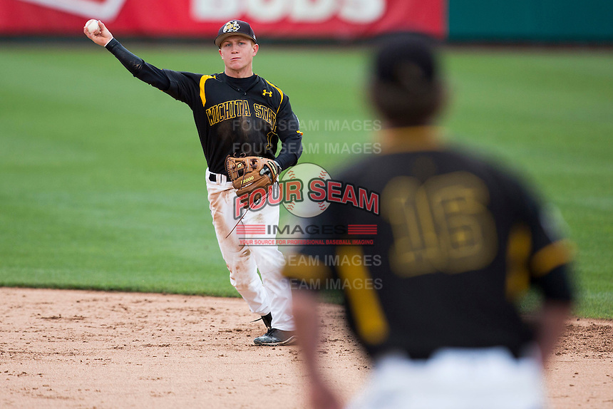 Tanner Dearman #1 of the Wichita State Shockers throws to first during a game against the Missouri State Bears at Hammons Field on May 4, 2013 in Springfield, Missouri. (David Welker/Four Seam Images)