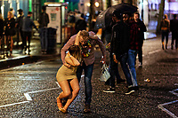 Pictured: A woman is grabbed by her partner. Sunday 31 December 2017 and 01 January 2018<br /> Re: New Year revellers in Wind Street, Swansea, Wales, UK