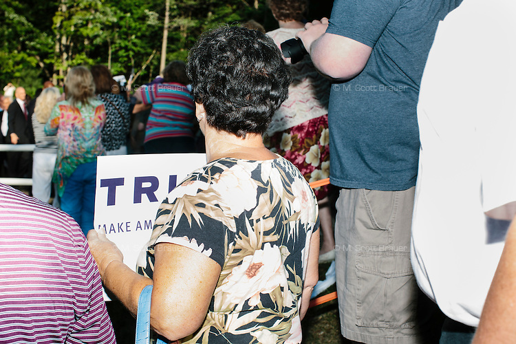 Crowds wait for the arrival of real estate mogul and Republican presidential candidate Donald Trump at a rally at the Weirs Beach Community Center in Laconia, New Hampshire.