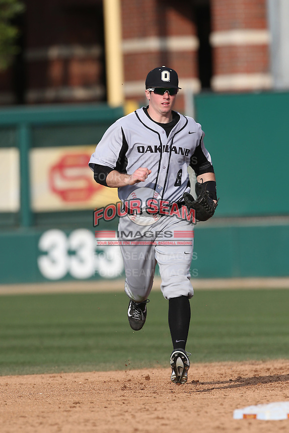 Tyler Pagano (8) of the Oakland Grizzlies during a game against the Southern California Trojans at Dedeaux Field on February 21, 2015 in Los Angeles, California. Southern California defeated Oakland, 11-1. (Larry Goren/Four Seam Images)