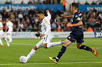 Martin Olsson of Swansea City (L) takes a cross during the Sky Bet Championship match between Swansea City and Leeds United at the Liberty Stadium, Swansea, Wales, UK. Tuesday 21 August 2018