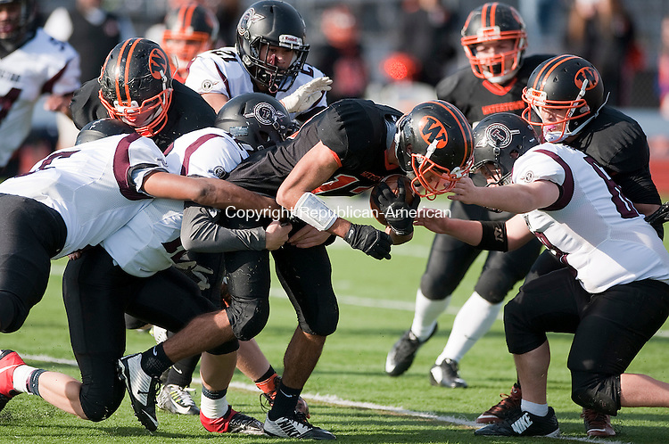 WATERTOWN, CT--- -112265JS05-Watertown's Jaylen Arline (13) gets brought down by a trio of Torrington defenders during their Thanksgiving day game Thursday at Watertown High School. <br /> Jim Shannon Republican-American