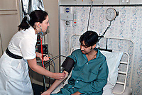 A nurse taking a patients blood pressure on a hospital ward...© SHOUT. THIS PICTURE MUST ONLY BE USED TO ILLUSTRATE THE EMERGENCY SERVICES IN A POSITIVE MANNER. CONTACT JOHN CALLAN. Exact date unknown.john@shoutpictures.com.www.shoutpictures.com...