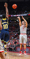 Ohio State Buckeyes guard Aaron Craft (4) takes an outside shot against Michigan Wolverines guard Derrick Walton Jr. (10) in first half action at Nationwide Arena on February 11,  2014. (Chris Russell/Dispatch Photo)