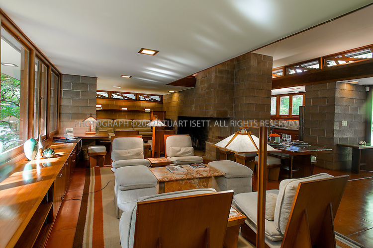 "10/9/2012--Sammamish, WA, USA..VIEW: Interior with dining table, living room area and kitchen (back right)..Architect Frank Lloyd Wright planned his ""Usonian"" homes to be affordable for middle-class families. The 1,9500 square foot Brandes home is for sale in Sammamish, Washington (30 minutes from Seattle) at $1.39 million. It features three bedrooms, two bathrooms and a small, separate office/study space...The home was built in 1952, and has redwood trim and Wright's original furniture and some garden sculptures by Wright. It's one of only three Frank Lloyd Wright homes near Seattle...©2012 Stuart Isett. All rights reserved."