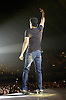 Enrique Iglesias<br /> Wembley Arena, London, Great Britain<br /> November 9, 2007 <br /> <br /> Photograph by Elliott Franks <br /> <br /> Enrique Iglesias (born Enrique Miguel Iglesias Preysler; May 8, 1975) is a Spanish-Filipino pop music singer, a son of Spanish singer Julio Iglesias and Filipina Isabel Preysler. Enrique started his musical career on Mexican label Fonovisa. This helped turn him into one of the most popular artists in Latin America and in the Hispanic American market in the United States, and the biggest seller of Spanish language albums of the 1990s.
