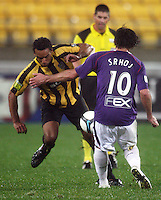 Phoenix' Paul Ifill tries to get past Wayne Srhoj during the A-League football match between Wellington Phoenix and Perth Glory at Westpac Stadium, Wellington, New Zealand on Sunday, 16 August 2009. Photo: Dave Lintott / lintottphoto.co.nz