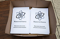 Pamphlets with resources for staying involved after the march rest on a table in Harvard University's Science Center Plaza in Cambridge, Massachusetts, before the March for Science demonstration on Sat., April 22, 2017.