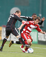 Kurt Morsink #6 and Rodney Wallace #22 of D.C. United go after Zach Loyd #19 of F.C. Dallas during a US Open Cup match on April 28 2010, at RFK Stadium in Washington D.C. United won 4-2.