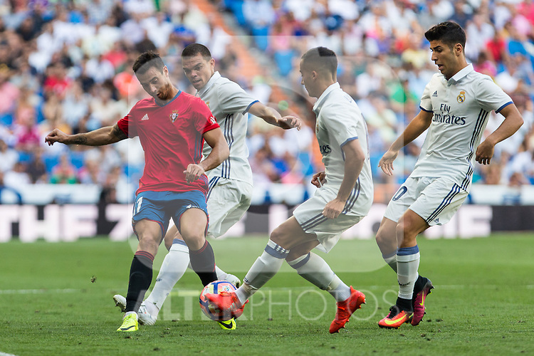Club Atletico Osasuna's Jaime Romero and Real Madrid's Pepe Lucas Vazquez and Avlaro Morata during the match of La Liga between Real Madrid and Club Atletico Osasuna at Santiago Bernabeu Estadium in Madrid. September 10, 2016. (ALTERPHOTOS/Rodrigo Jimenez)