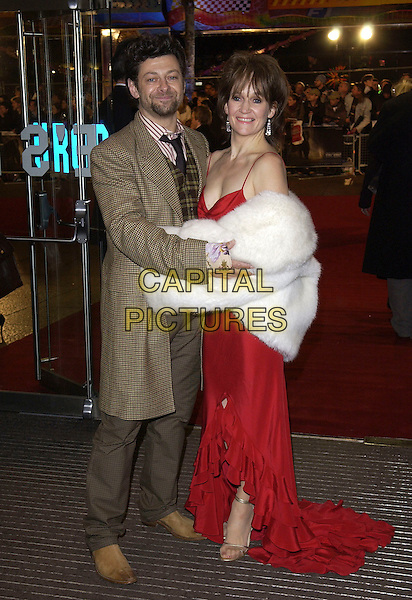 """ANDY SERKIS & LORRAINE SERKIS.""""King Kong"""" UK film premiere.Odeon Leicester Square.London England 8 December 2005.Ref: FIN.full length white fur red dress brown checkered jacket.www.capitalpictures.com.sales@capitalpictures.com .© Capital Pictures."""