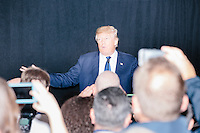 Republican presidential candidate and real estate mogul Donald Trump speaks at a meeting of the New England Police Benevolent Association executive council at the Sheraton Portsmouth Harborside Hotel in Portsmouth, New Hampshire, USA. At the gathering, the group endorsed Trump for president. A small group of perhaps 20 Trump supporters stood outside the hotel and there was a larger group of anti-Trump protesters, mostly across the street. One of the protest organizers estimated that there were around 230 protesters gathered.Many protesters expressed disagreement with Trump's recent statements that he would ban all Muslims from entering the country. Trump brought up the recent shooting in San Berdardino, Calif., at the meeting.