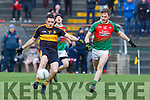 Brian Looney Dr Crokes gets his shot away with Gary O'Leary Kilcummin in pursuit during their East Kerry clash in Killarney on Saturday