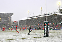 Leicester, England. Ground staff clear the lines during the Heineken Cup match between Leicester Tigers and Toulouse  at Welford Road on January  20. 2013 in Leicester, England..