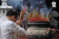 Man praying with incense in hand (Licence this image exclusively with Getty: http://www.gettyimages.com/detail/83154178 )