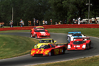 LEXINGTON, OH - JUNE 10: The Alba/Momo AR3 001/Ford of Gianpiero Moretti and Fulvio Ballabio leads a group of cars through the Carousel turn during the Lumbermen's 500 IMSA GT race at the Mid-Ohio Sports Car Course near Lexington, Ohio, on June 10, 1984.