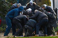 """Filming of """"The Batman"""" in London.  A scene in a recreation of New York's Central Park  where a jogger (stunt double for Robert Pattinson) is mugged.  <br /> The film is planned to be released in 2021.<br /> London, England on February 13, 2020.<br /> CAP/IH<br /> ©Ivan Harris/Capital Pictures /MediaPunch ***NORTH AMERICA ONLY***"""