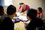 Sophia Sawyer, center, helps her children with their homework January 27, 2010 in Sacramento, Calif. The Sawyer family receives $540/month in CalWORKs assistance from the state of California. Dennis is currently unable to work while recovering from cancer, and Sophia hasn't been able to find work. Gov. Arnold Schwarzenegger has proposed eliminating the CalWORKs program in an effort to balance the state's budget. CREDIT: Max Whittaker for The Wall Street Journal.CABUDGET