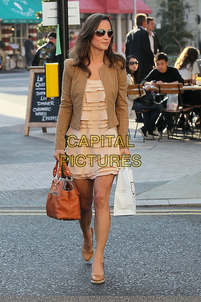 Pippa Middleton on her way to work,.London, England..28th September 2011.full length sunglasses shades pink dress layered layers beige blazer jacket bag purse brown wedges shoes takeaway.CAP/HIL.©John Hillcoat/Capital Pictures .