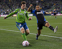 Mike Fucito of the Seattle Sounders FC looks to pass while Justin Morrow of the San Jose Earthquakes defends during play at CenturyLink Field in Seattle Saturday October 15, 2011. The Sounders FC won the game 2-1.