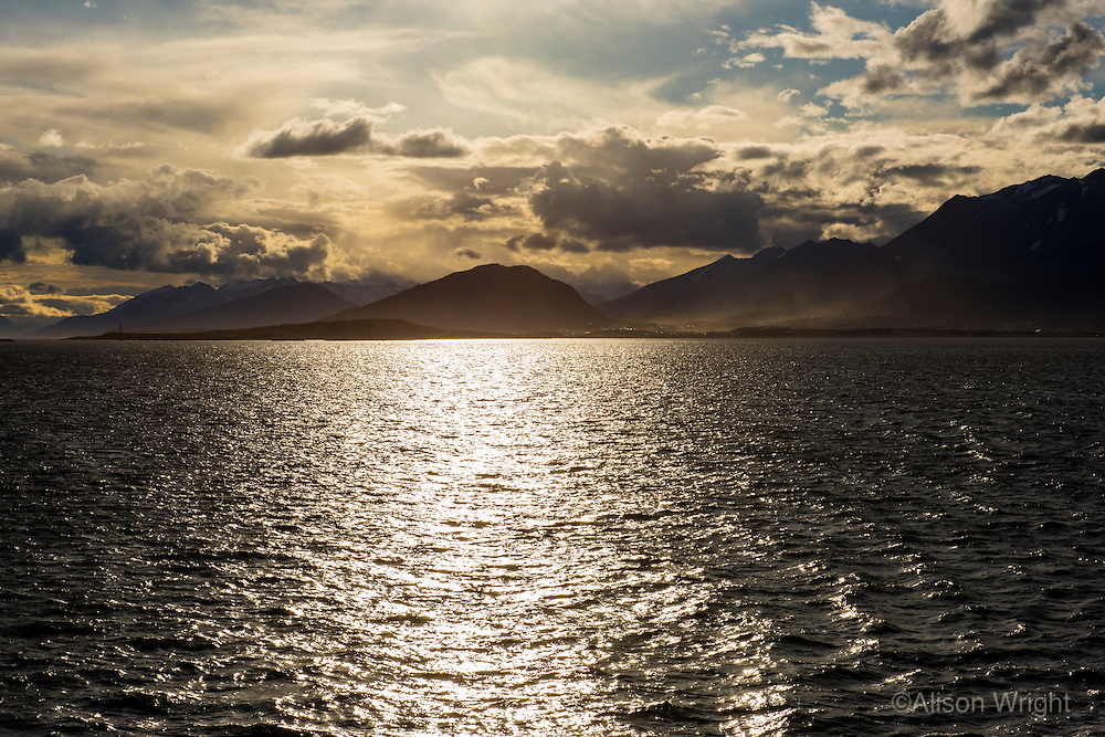 Argentina, Ushuaia, Antarctica expedition aboard the Hurtigruten FRAM ship. Leaving the port at sunset.